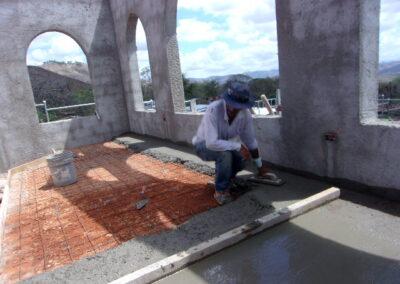 man working on church floor