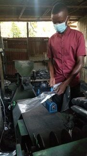 young man packaging business goods